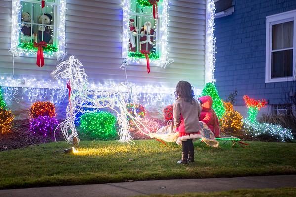 JOED VIERA/STAFF PHOTOGRAPHER Lockport, NY-Cecilia Ramos 3 admires the Christmas lights on Maple Street home.