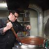 JOED VIERA/STAFF PHOTOGRAPHER Lockport, NY-Dominick  DeFlippo stirs sauce at his restaurant.