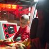 JOED VIERA/STAFF PHOTOGRAPHER Lockport, NY-Tyler Mistalski plays in a fire engine.
