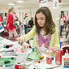 JOED VIERA/STAFF PHOTOGRAPHER Pendleton, NY-Julia Muscarella 7 makes Christmas crafts at Starpoint's Winterfest.