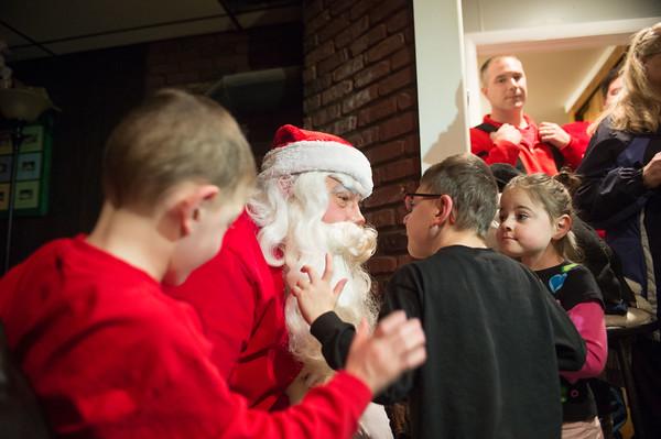 JOED VIERA/STAFF PHOTOGRAPHER Lockport, NY-Santa Pays a visit to the family's home.