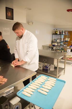 JOED VIERA/STAFF PHOTOGRAPHER Lockport, NY-Peter Flanagan prepares pretzels  in his kitchen at the YWCA.