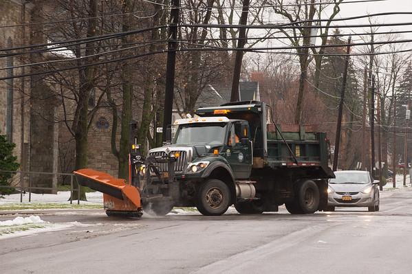 JOED VIERA/STAFF PHOTOGRAPHER Lockport, NY-A city plow drives down Ontario Street.