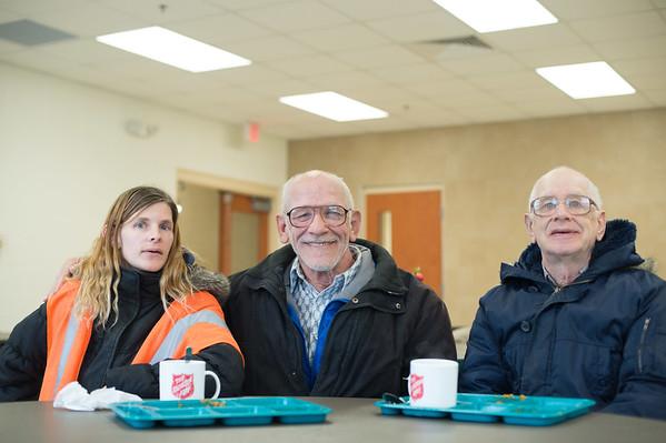 JOED VIERA/STAFF PHOTOGRAPHER Lockport, NY-Ashley Falls, Wayne Budde and Fred Budde enjoy a meal at the Sister Mary Loretto soup kitchen.