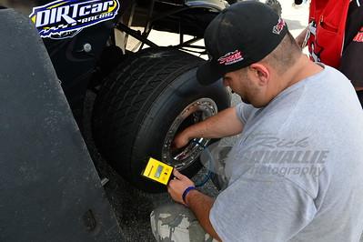 Jimmy Owens crew member - Keir Hoover checks tire pressure