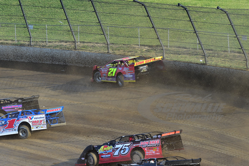 Billy Moyer hits the wall going in to Turn 1
