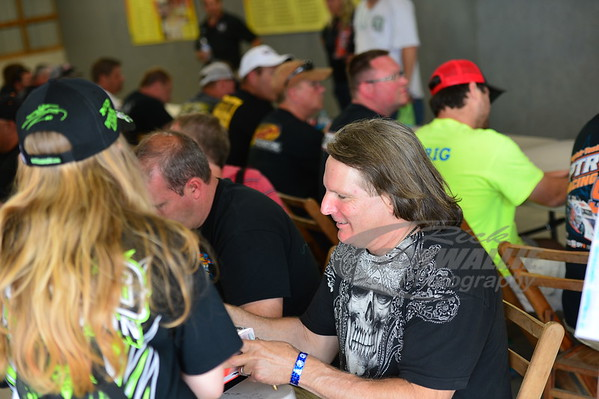 Scott Bloomquist signs an autograph