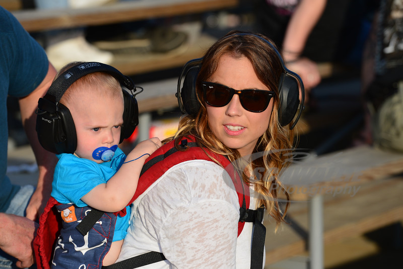 A young race fan watches