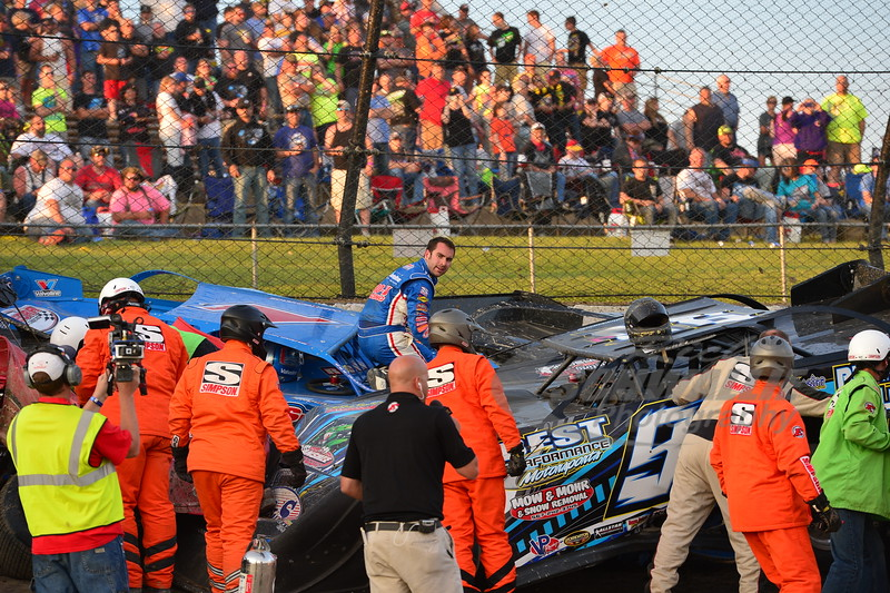 Josh Richards climbs atop his car after getting into a wreck.