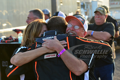 Josh Rice receives a hug from his car owners