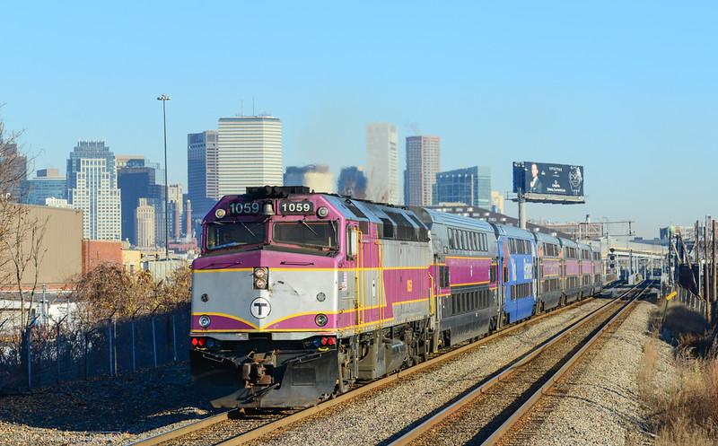 MBTA 1059 with outbound Fairmont Line train 751 at Newmarket, Boston.