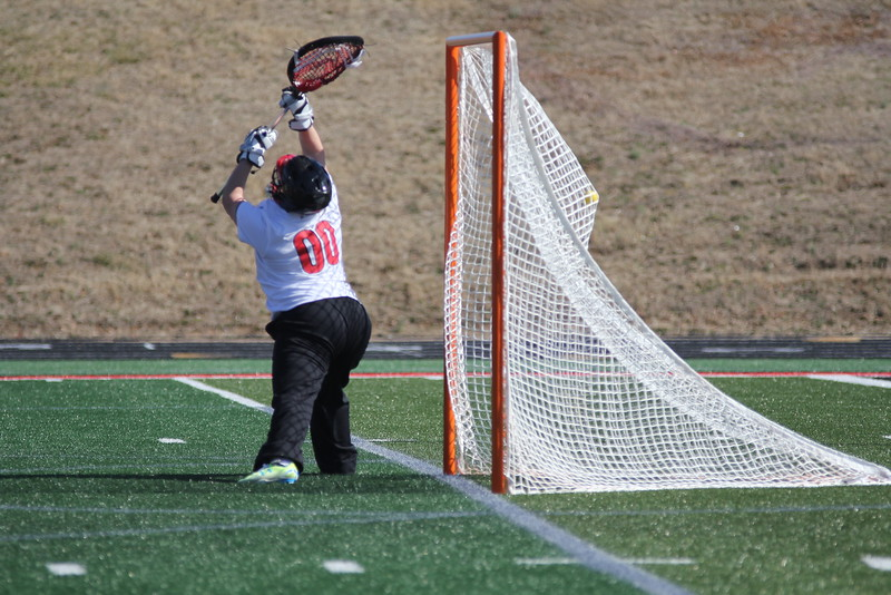 00, Reagan Hall tries to defend the goal.
