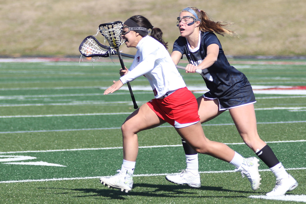 7, Michelle Hedrick recovers the ball and runs toward the goal.