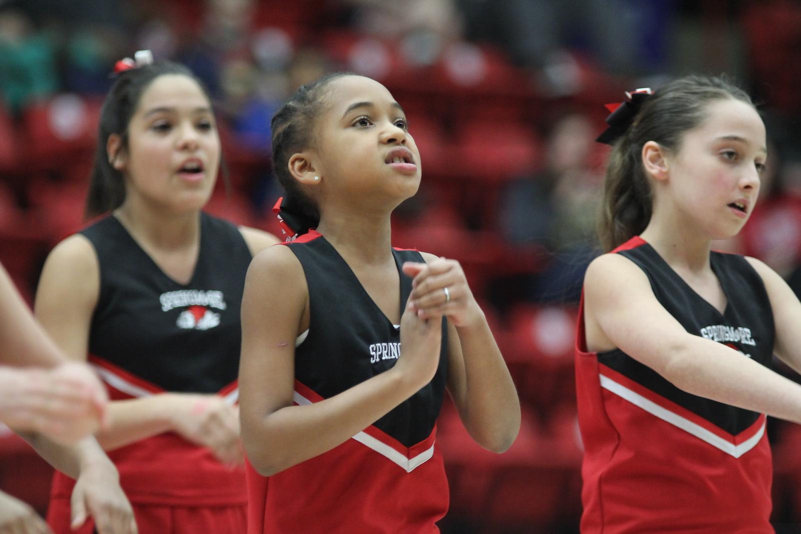 Cheerleaders from Springmore Elementary School performed during halftime.
