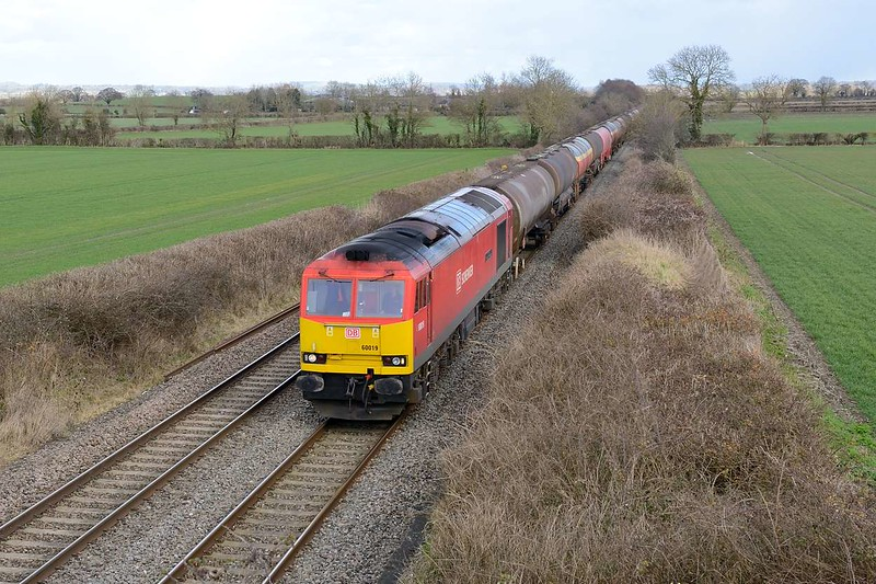 21 February 2015 :: 6B33 from Theale to Margam was today routed over the B&H line and is seen near Edington, Westbury powered by 60019
