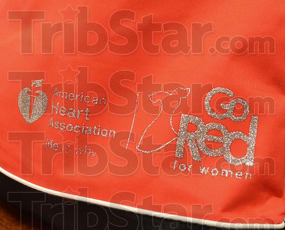 MET 020815 GO RED BAG