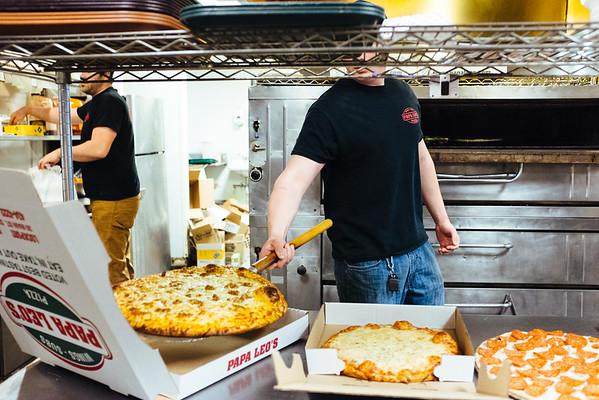 JOED VIERA/STAFF PHOTOGRAPHER- Lockport, NY-Stone Rutcen takes a pizza outside of the oven at Papa Leo's. Friday, January, 30, 2015