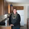 JOED VIERA/STAFF PHOTOGRAPHER- Cheektowaga, NY-Alyshia Woolley stands in her new kitchen. Wednesday, February, 4, 2015