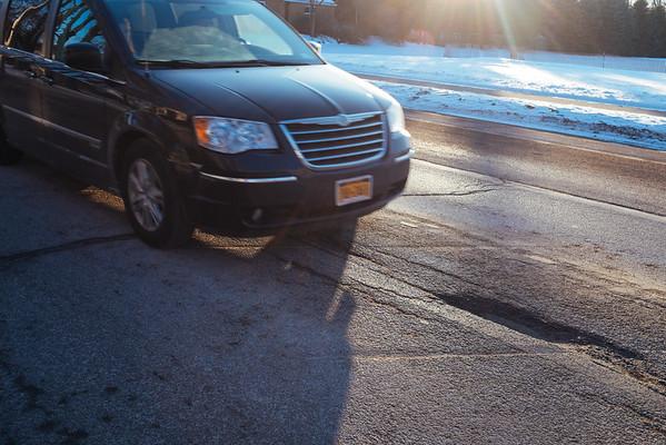 JOED VIERA/STAFF PHOTOGRAPHER- Lockport, NY-A car goes over a pothole on Locust Street. Friday, January, 23, 2015