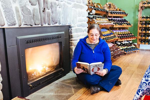 JOED VIERA/STAFF PHOTOGRAPHER- Lockport, NY-Margo Sue Bittner reads books at Winery at Marjim Manor. Friday, January, 30, 2015