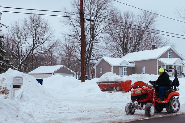 JOED VIERA/STAFF PHOTOGRAPHER- Lockport, NY-Ken Kobylanski uses a kubota lawn tractor to plow his driveway on Market Street.. Tuesday, February, 10, 2015