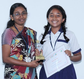 Middle Wing Coordinator Ms. Swapna Kannedi with, Lekha (Stage 9) -  the star performer in English in the Secondary Checkpoint Examinations 2015