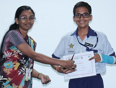 Middle Wing Coordinator Ms. Swapna Kannedi with, Kshitij Madduri  (Stage 9) -  the star performer  in the Secondary Checkpoint Examinations 2015