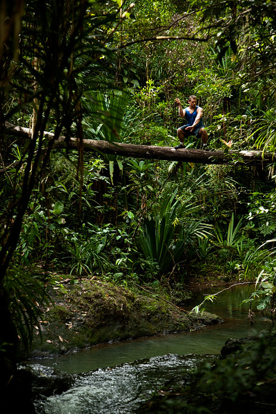 Kelsey strikes a pose while perched high over Waisila Creek in the jungle near Suva, Fiji.