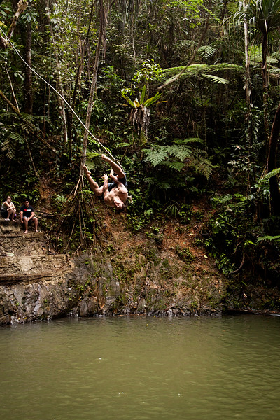 Kelsey takes a swing into a deep pool in Waisila Creek to cool off after a long day of wandering through the jungle.