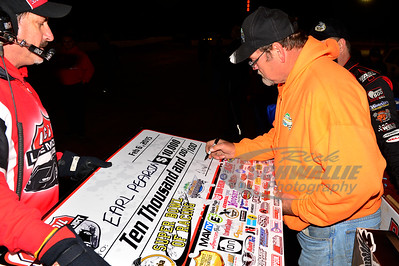 Golden Isles Speedway promoter - Darryl Courson signs the big check