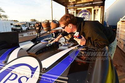 Lance Landers cleans on his son's car - Jared Landers