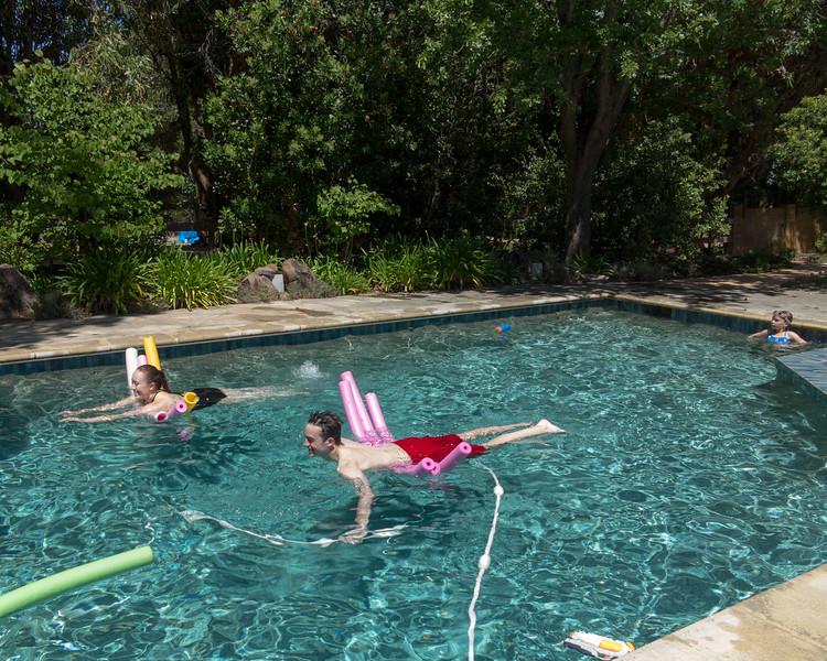 Isabel and Benjamin swimming, with Hannah watching
