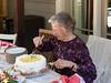 José cutting her birthday cake
