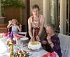 Readying the cake: Hannah, Chantal, and José