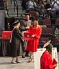 Isabel receiving diploma folder