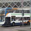 Stagecoach 55-branded Enviro 400 VX61FKJ 15735 leaving Swindon bus station for Cheltenham.