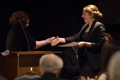 Emily DeVries being installed as Secretary for Lambda Pi Eta.