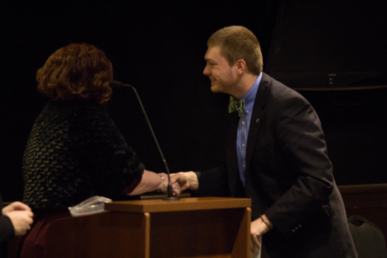 Collin Helms being installed as Lambda Pi Eta President.