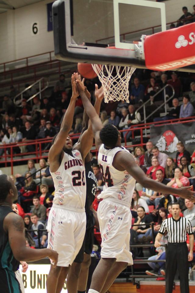 20, Tyrell Nelson, scores a basket.
