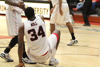 Teammate helps Jerome Hill up after falling in the game.