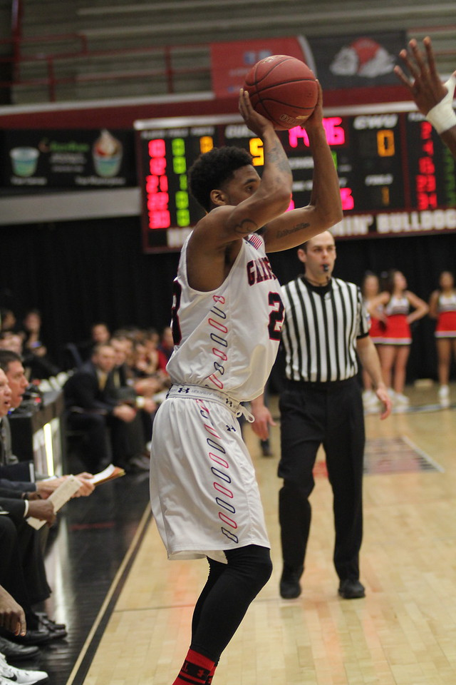 23, Adonis Burbage shoots a basket.
