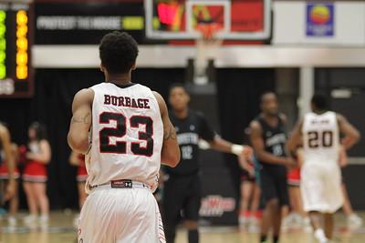 23, Adonis Burbage, runs toward the basket.