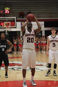 20, Tyrell Nelson, shoots a basket.