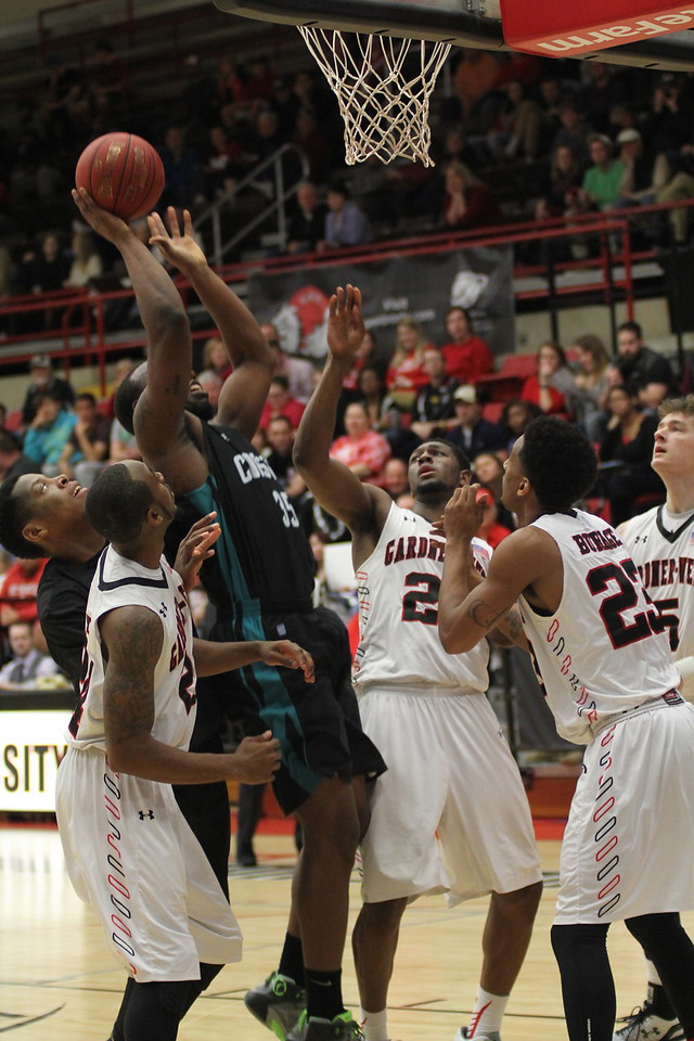 GWU fight to stop Coastal from scoring.
