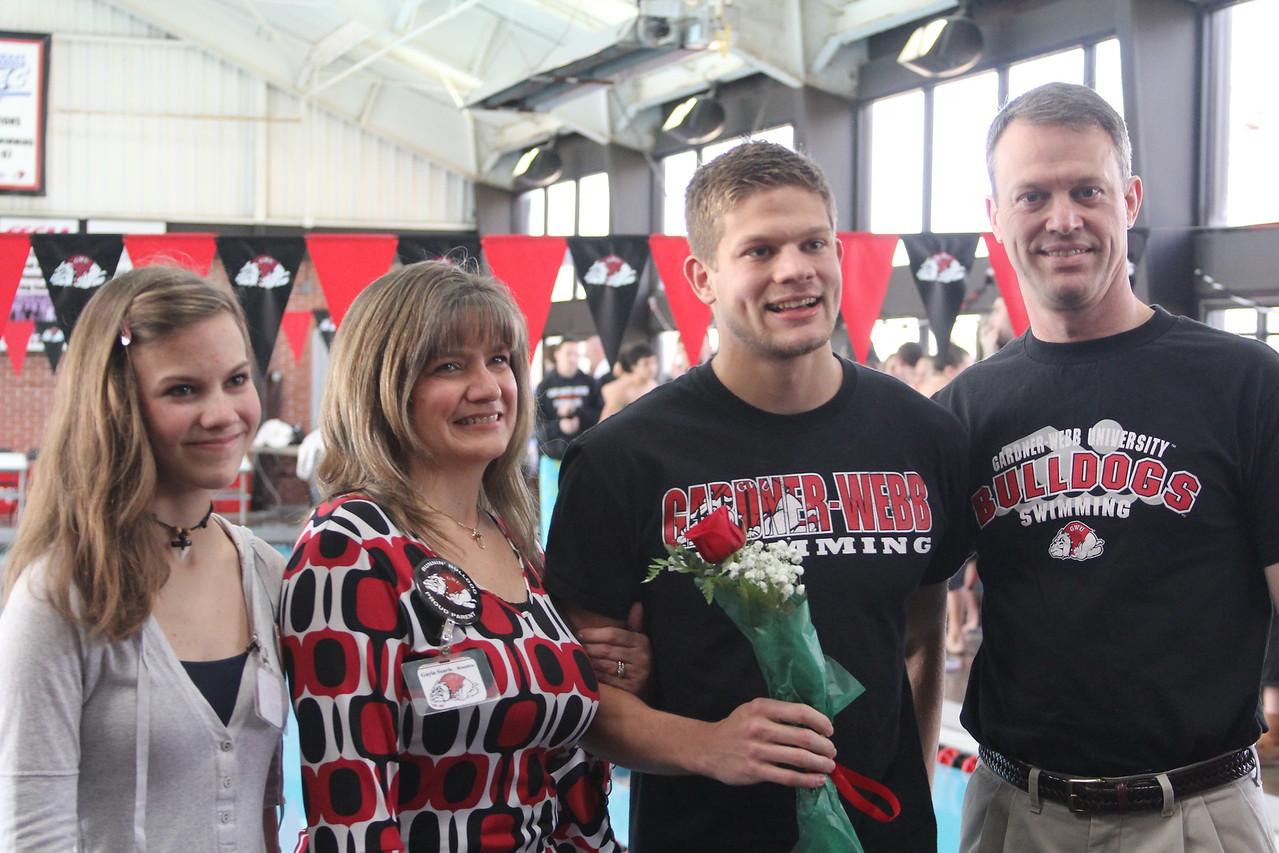 Senior, Brandon Searle, is honored at the senior home swim meet on Saturday, January 31st against Davidson.