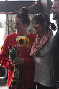Senior, Jenna Ballinger, is honored at the senior home swim meet on Saturday, January 31st against Davidson.