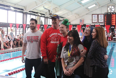 Senior, Mary O'Doherty, is honored at the senior home swim meet on Saturday, January 31st against Davidson.