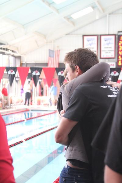 Senior, Joe MacGregor, is honored at the senior home swim meet on Saturday, January 31st against Davidson.