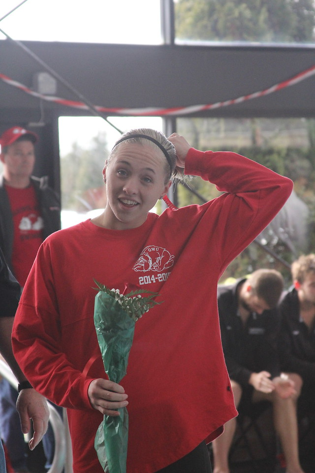 Senior, Charity Byrum, is honored at the senior home swim meet on Saturday, January 31st against Davidson.
