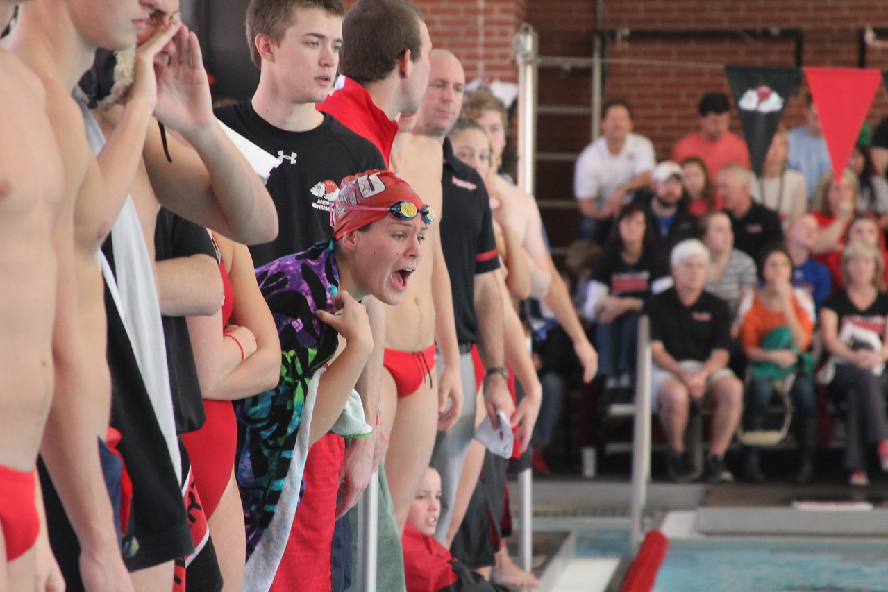 Swimmers cheer on teammates.